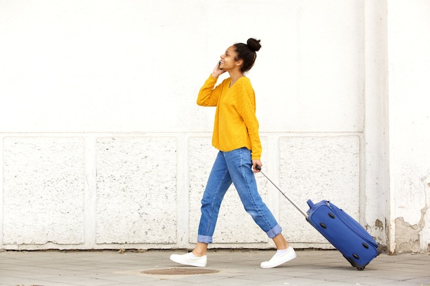 Traveling woman talking on mobile phone