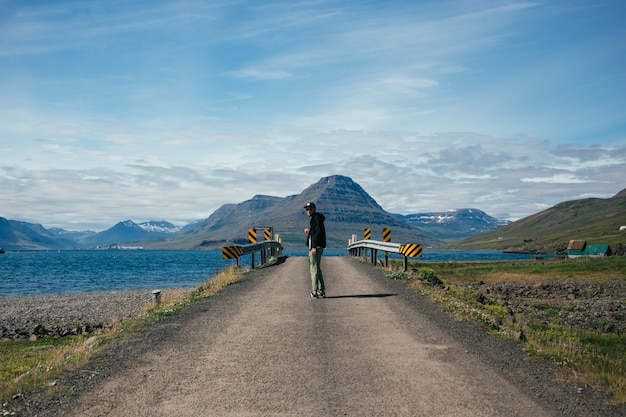 Traveller man with backpack explores iceland
