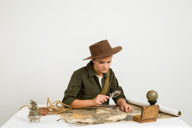 Traveller searching with a magnifying glass
