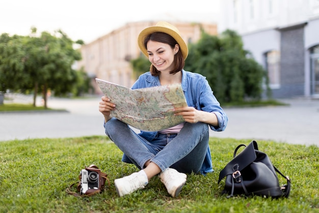 Traveller with hat checking local map