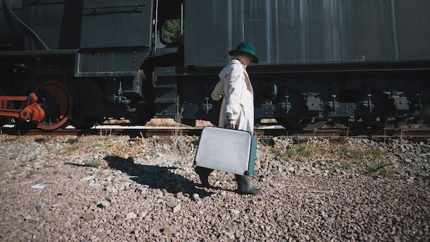 Traveller woman walking to train