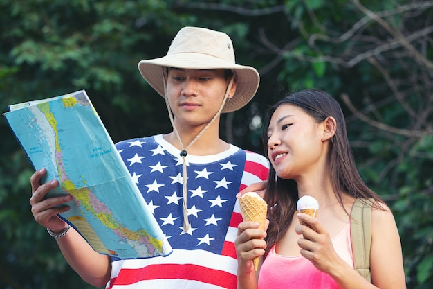 Travellers using map at countryside