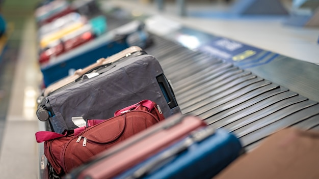 Travelling bags on conveyor belt at the airport