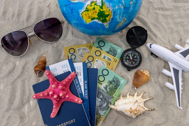 Travelling concept with australian dollar, passport and globe