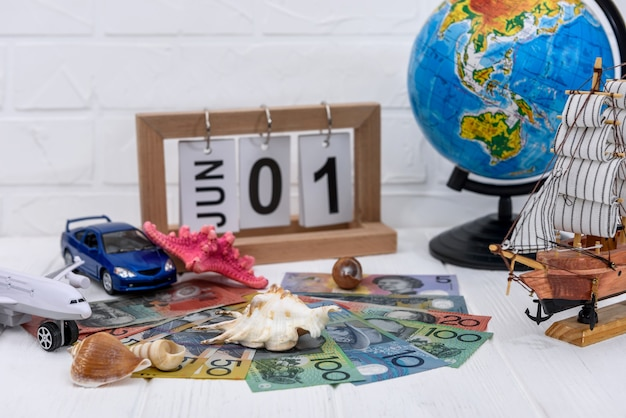 Travelling concept with toy car, plane and globe