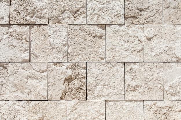 Мрамор травертино на белом фоне стены