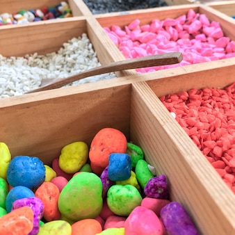 Tray of colorful fine stone for creating beautiful plant pot.