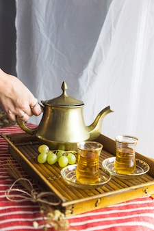 Tray of moorish tea with grapes