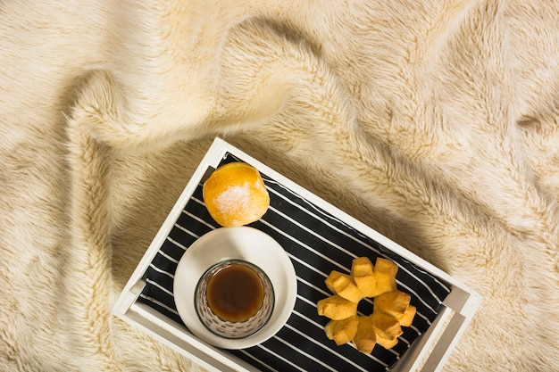 Tray with breakfast on fur blanket