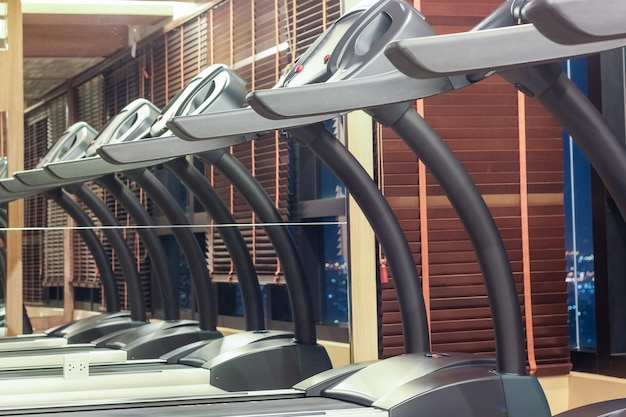 Treadmill in gym with mirror reflection
