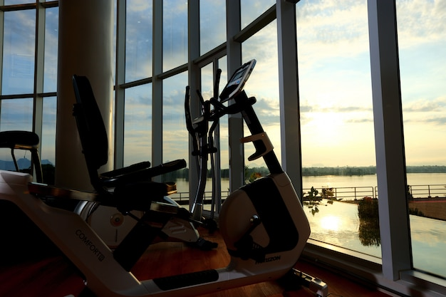 Treadmill interior with forest river sky cloud view in sunrise