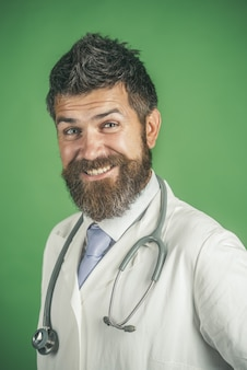 Treatment healthcare medicine and ambulance services concept doctor with beard happy face in white