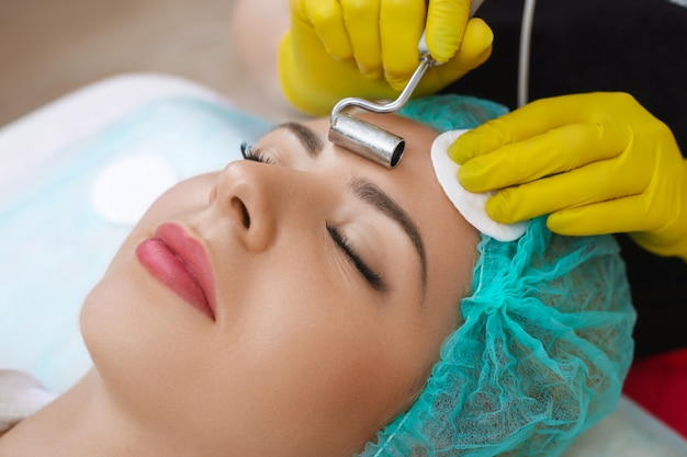 Treatment with device of facial cosmetology.