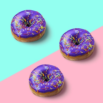 Tree donut with violet glaze and icing on pink and blue background fashion minimalism style flat lay