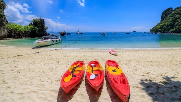 Tree red kayak on the sand beach at railay beach ao nang krabi thailand