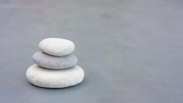 Tree round stones on gray pastel background. zen like concept.