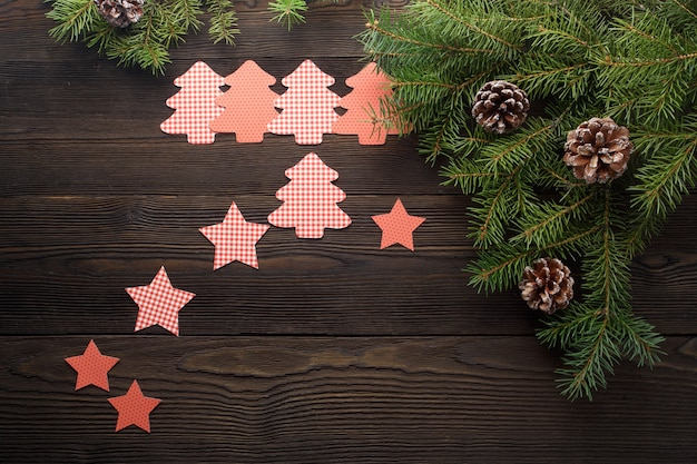 Trees cut out with stars on a dark wooden table