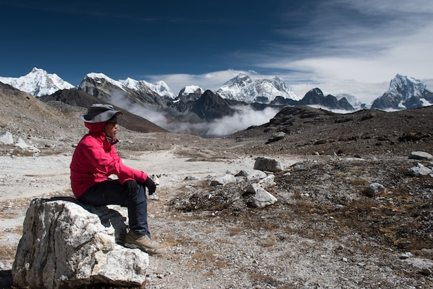 Trekker on the way from lobuche to gokyo village with naktok lake and mountain in nepal