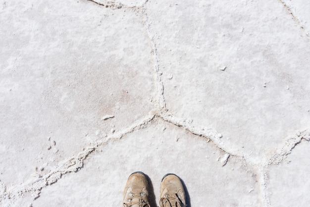 Trekking boots on the uyuni salt fl, bolivia