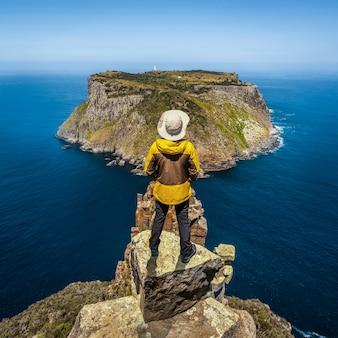 Trekking in tasman peninsula, tasmania, australia.