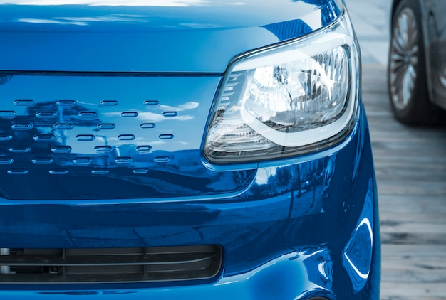 The trend color of the year 2020 classic blue. sports car front view, close-up