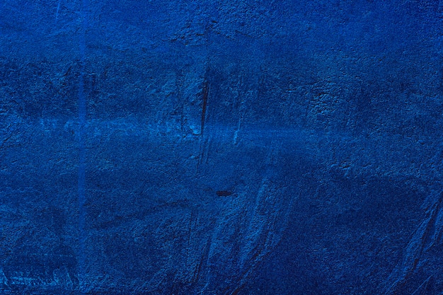 The trend color of the year 2020 classic blue. style concrete wall close-up texture background