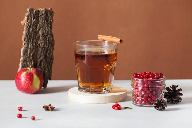 Trending photo of autumn hot tea with spices and berries. autumn mood..