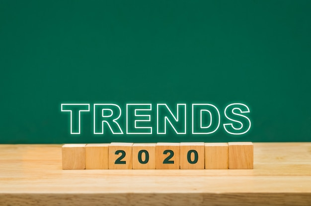 Trends 2020 idea on wood cube block on table with green blackboard