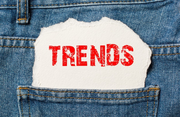 Trends on white paper in the pocket of blue denim jeans