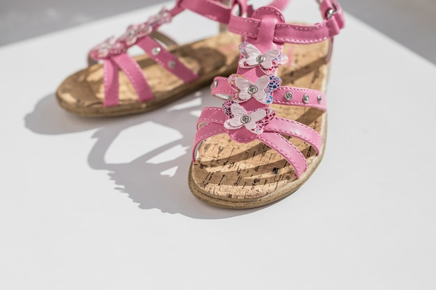 Trendy baby pink sandals.close up of baby shoes, kids summer fashion. shoes for girls, children's slippers, beach fashion for baby,