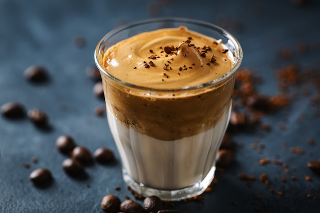 Trendy coffee drink dalgona with milk and whipped  foam made from instant coffee and sugar.