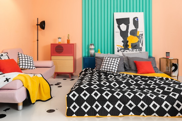 Trendy colorful bedroom with bright patterned textile.