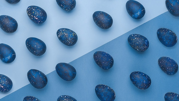 Trendy easter egg pattern of color of the year-classic blue with gradient effect.