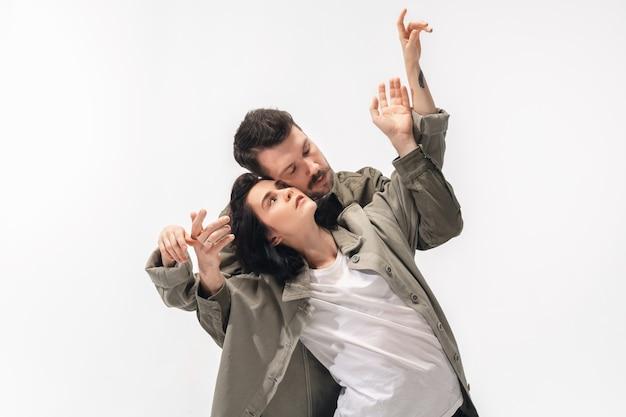 Trendy fashionable couple isolated on white  surface