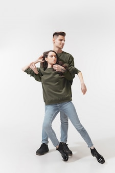 Trendy fashionable couple posing