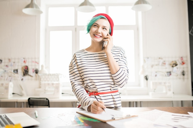 Trendy female manager working in atelier