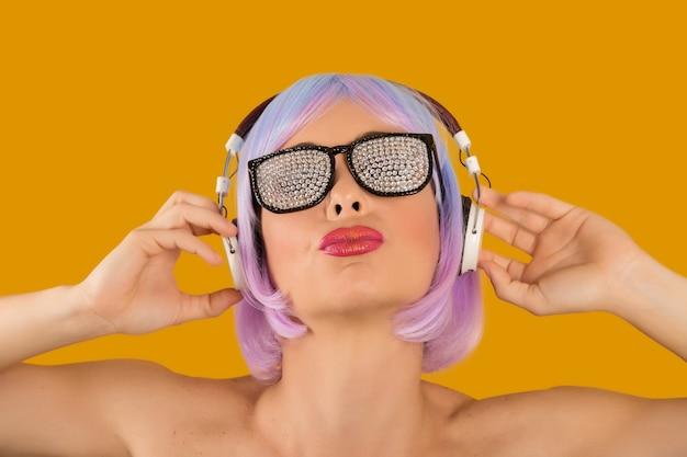Trendy glamorous woman in headphones