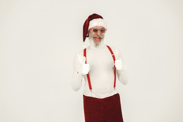 Trendy grey-haired santa. man wear knitted clothes. grandfather in a santa's hat.