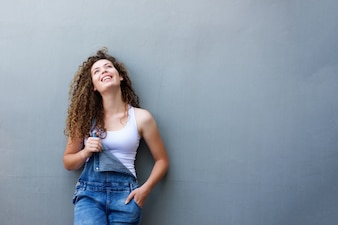 Trendy happy teen girl standing with hand in pocket