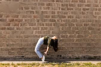 Trendy hip-hop female dancer bending backward