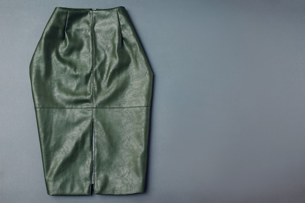 Trendy leather skirt. spring female clothes outfit. stylish green skirt from ecoligical material. fashion. space