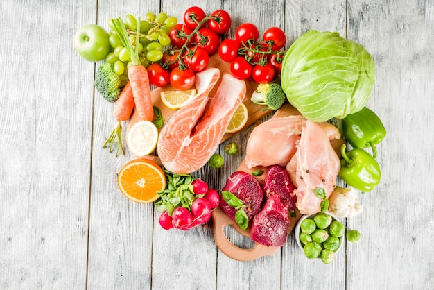 Trendy pegan diet, meat, eggs, seafood, dairy products and various fresh vegetables
