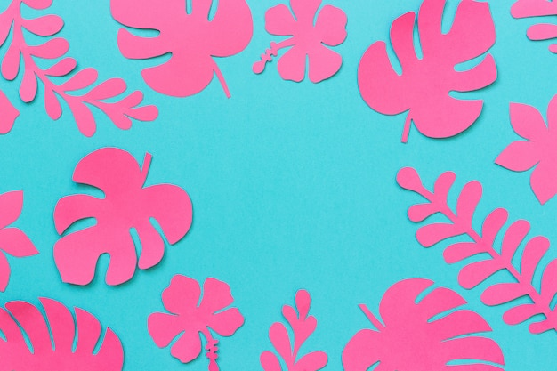 Trendy pink tropical leaves of paper
