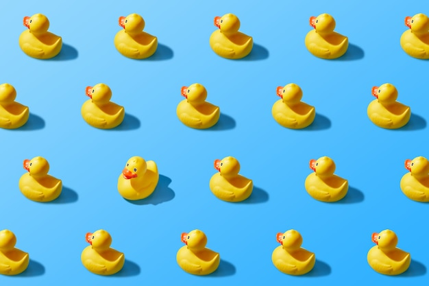 Trendy pop art design of a yellow rubber duck pattern from a top view. dissenting opinion, chosen one, not like everyone else.