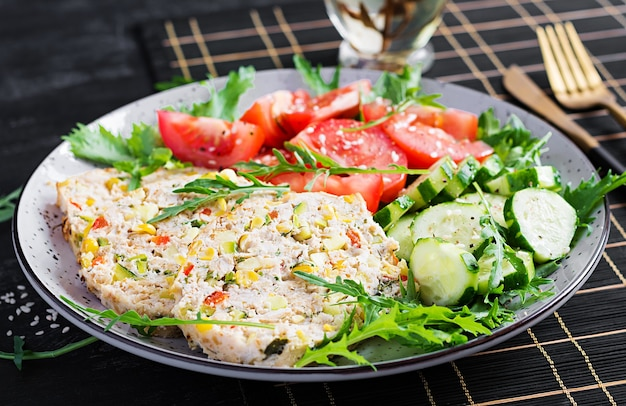 Trendy salad. chicken meatloaf with salad fresh tomatoes and cucumber. healthy food, ketogenic diet, diet lunch concept. keto, paleo diet menu.