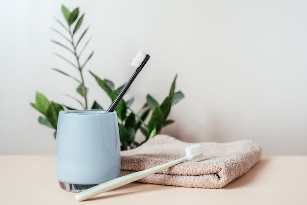 Trendy soft bristles toothbrushes on a bath towel, ultra-fine toothbrush with nano million bristles, dental care and hygiene trends