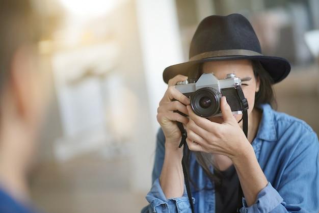 Trendy stunning brunette with vintage camera