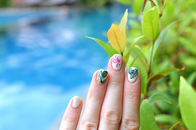 Trendy summer manicure flamingoes palm leaves swimming pool vacation