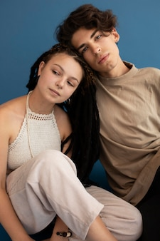 Trendy teenager boy and girl posing together