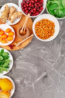 Trendy virus protection food, coronavirus, immunity concept. assortment product of rich in antioxidants and vitamins sources on grey background, healthy food nutrition dieting concept.